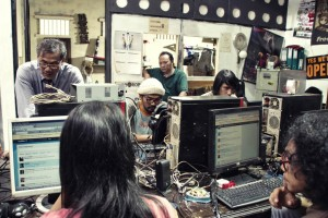 Netizens Tweeting in Internet Cafe