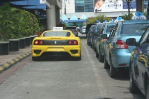 Ferrari and Porsche taxi service in Indonesia.