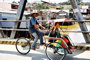 Typical rickshaw in Indonesia that fits 2 passengers