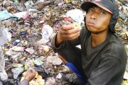 Scavenger eating lunch in waste dump