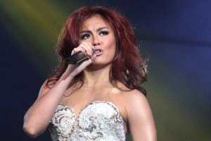 Indonesian singer Agnes Monica singing.