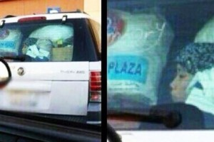 Indonesian maid sat at the back of her employer car like slave in Saudi