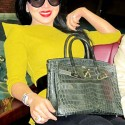 Syahrini Holding a Grey Hermes Bag Made from Snakeskin